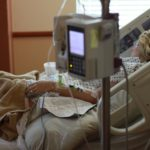 Nursing Home Patient in Hospital Bed